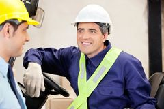 Forklift Driver Looking At Supervisor Royalty Free Stock Photos