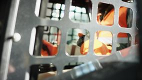 Forklift driver in protective vest driving forklift at warehouse of freight forwarding company. Man on the forklift stock footage