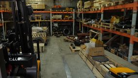 Forklift driver in protective vest driving forklift at warehouse of freight forwarding company. Man on the forklift. Drives into the garage stock photos