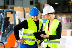 Forklift driver and supervisor at warehouse Royalty Free Stock Photo