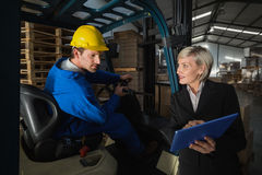 Forklift driver talking with his manager Royalty Free Stock Images