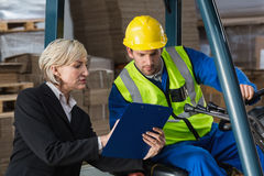 Forklift driver talking with his manager Stock Image