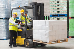Forklift driver talking with his manager Royalty Free Stock Photography