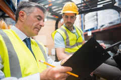 Forklift driver talking with his manager Stock Photography