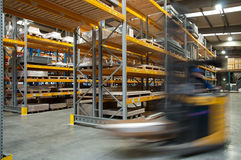 A forklift driving through a warehouse
