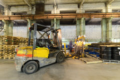 Forklift drove rack with load chains. Large industrial enterprises department royalty free stock photos