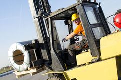 Forklift in front of production hall Royalty Free Stock Photos