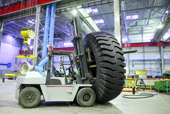 Forklift with giant size tyre Stock Photography