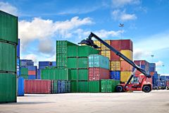 Forklift handling the container Stock Image