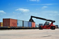 Forklift handling the container Stock Photos