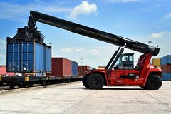 Forklift handling the container. Box stock images