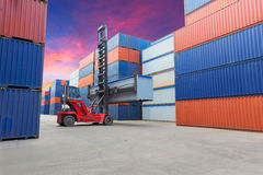 Forklift handling the container box at dockyard with beautiful s. Ky royalty free stock photography