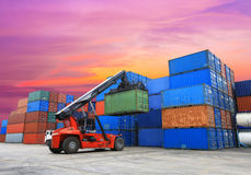Forklift handling the container box at dockyard Stock Image