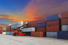 Forklift handling the container box at dockyard Stock Photos