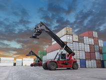 Forklift handling the container box at dockyard Royalty Free Stock Photos