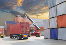 Forklift handling the container box at dockyard Royalty Free Stock Image
