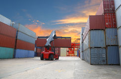 Forklift handling the container box at dockyard with harbour bac Royalty Free Stock Photography