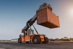 Forklift handling container box loading Stock Photos