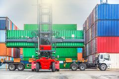 Forklift handling container box loading at the docks with truck, Crane handling cargo container loading to container trailer in i royalty free stock photos