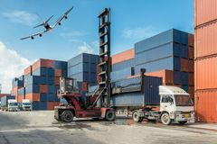 Forklift handling container box loading at docks with truck for stock photography