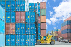 Forklift handling container box loading to depot Stock Photography