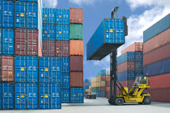 Forklift Handling Container Box Loading To Truck Stock Images