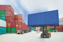 Forklift handling container box loading to truck in import expo Royalty Free Stock Photography