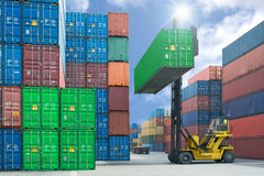 forklift handling container box loading to truck in import export logistic zone royalty free stock photos
