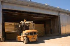 Forklift handling timber 3. Forklift loading timber drying kilns Stock Image