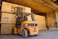 Forklift handling timber 4. Forklift loading timber drying kilns Stock Photo