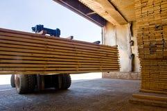 Forklift handling timber 5. Forklift loading timber drying kilns Royalty Free Stock Photo