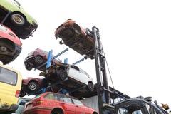 Forklift hoisting car wrecks Royalty Free Stock Photo
