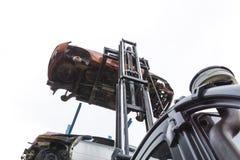 Forklift hoisting car wrecks Royalty Free Stock Photos