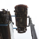 Forklift hoisting car wrecks Stock Images