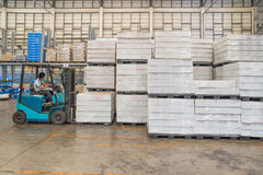 Forklift in the large modern warehouse Royalty Free Stock Photography