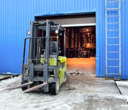 Forklift at large warehouse Royalty Free Stock Images