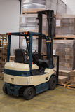 Forklift in a large warehouse Stock Photography