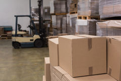 Forklift in a large warehouse Royalty Free Stock Images