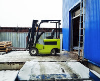 Forklift at large warehouse royalty free stock photography