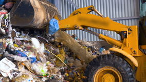 Forklift, lift truck loading a pile of trash at landfill. 4K stock footage