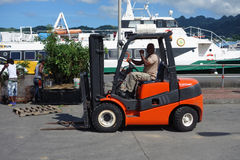 A forklift for lifting cargo at the grenadines wharf in st. vincent Royalty Free Stock Image