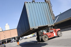 Forklift lifting container Stock Image