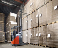 Forklift lifting from top shelf Royalty Free Stock Photos