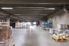Forklift loader and boxes at warehouse. Logistic, storage, loading, shipment and equipment concept - forklift loader and boxes at warehouse Stock Images