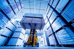 Free Forklift Loader In Storage Warehouse Ship Yard. Distribution Products. Royalty Free Stock Images - 172183009