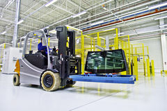 Forklift loader in large modern warehouse Royalty Free Stock Image