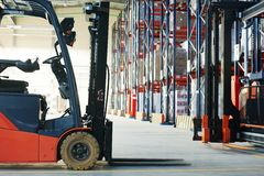 Forklift loader stacker truck at warehouse Royalty Free Stock Images