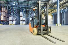 Forklift loader stacker truck at warehouse Royalty Free Stock Image