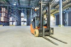 Forklift loader stacker truck at warehouse Royalty Free Stock Image