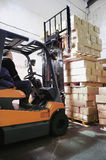 Forklift loader in warehouse Royalty Free Stock Photos